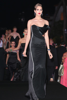 A model walking on the Cannes 2015 Gyunel catwalk